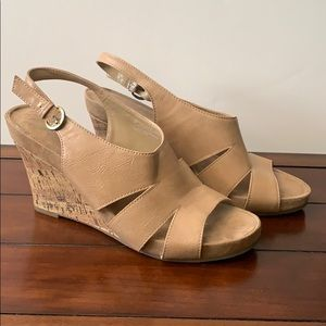 Tan wedge sandals with cork heels.